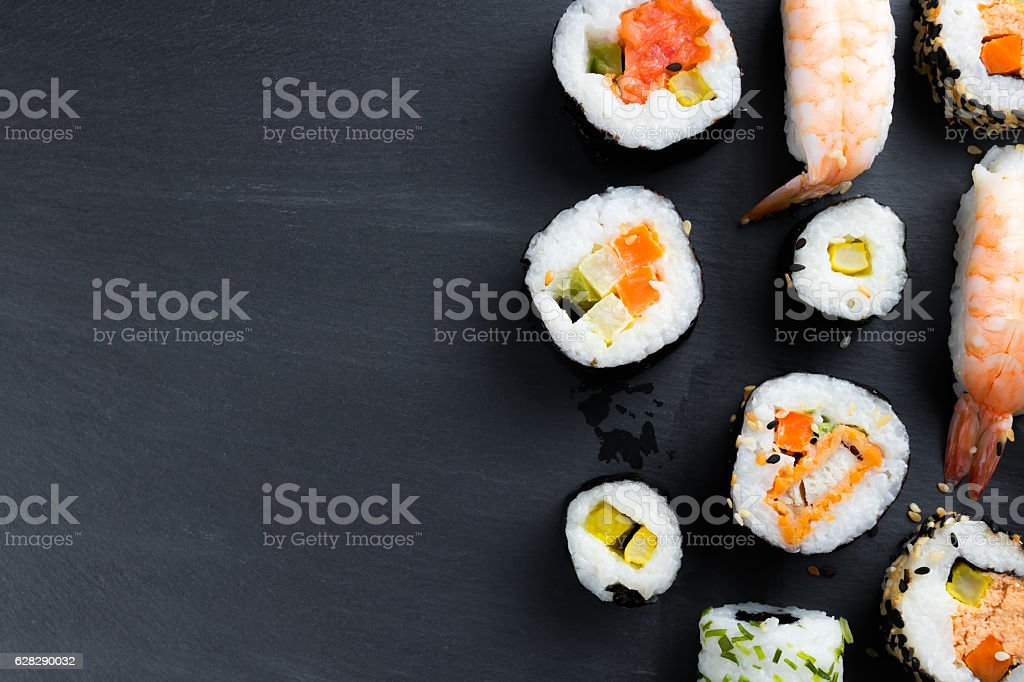 Typical asian cuisine set on black kitchen slate plate. stock photo