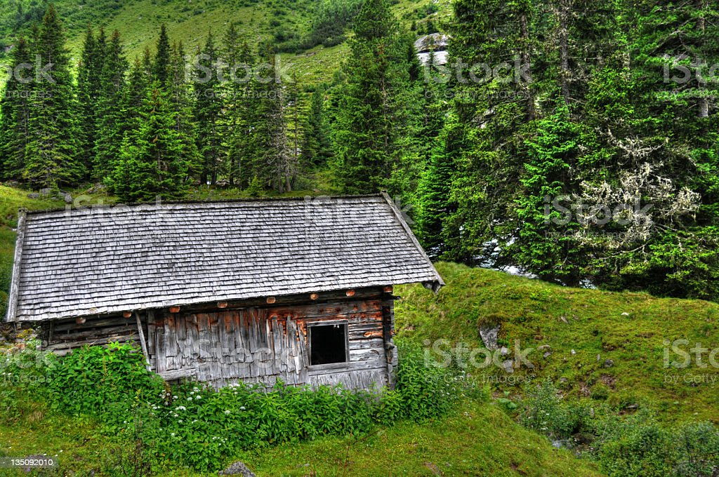 HDR typical austrian barn and animal pen in mountain range royalty-free stock photo