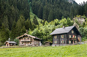 Typical Austrian farmhouses and sheds in in the hamlet Breitlahner, Tirol, Austria