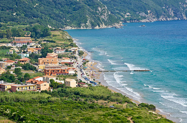 Typical bay with little town Arillas - Corfu, Greece stock photo