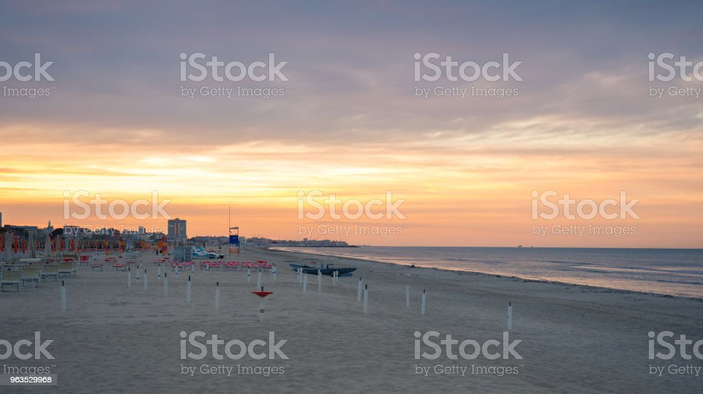 Typical beach of the Romagna Riviera at sunset. stock photo