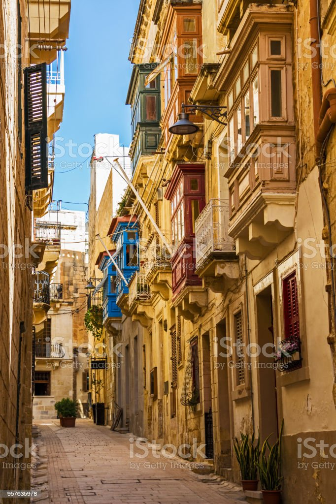 Typical beautiful narrow lane in Birgu, Vittoriosa - one of the Three fortified Cities of Malta stock photo