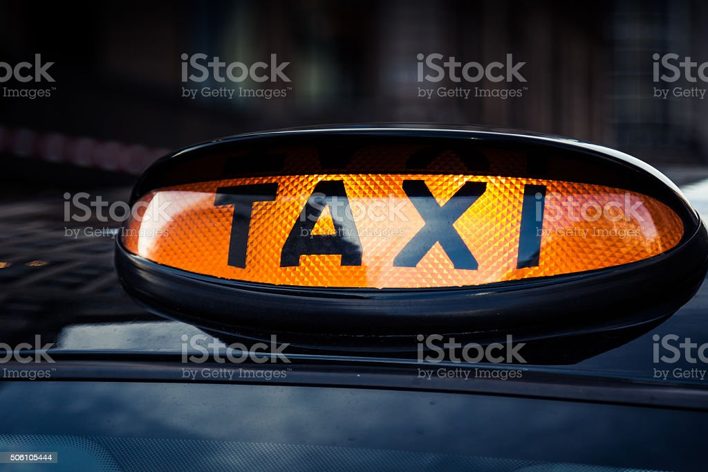 Typical black taxi cab in Central London stock photo