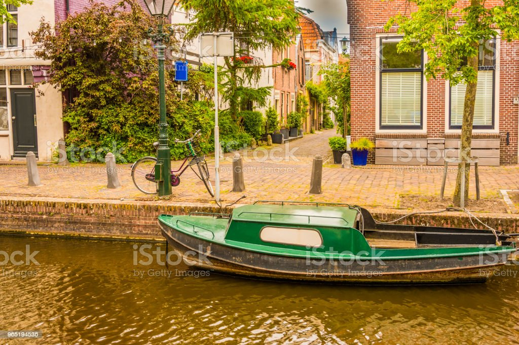 Typical boat in an alkmaar channel. netherlands holland royalty-free stock photo