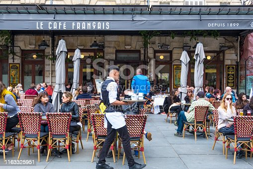 Bordeaux, France - May 5, 2019: A people relax in Cafe Francais on Place Pey Berland in Bordeaux, Aquitaine, France