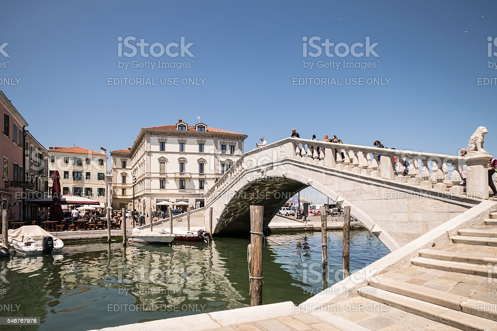 Typical bridge across a canal in Chioggia, Venice, Italy. stock photo