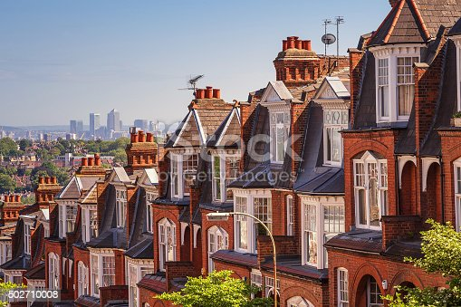istock Typical British brick houses on a sunny afternoon panoramic shot 502710008