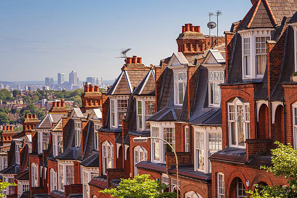 Typical British brick houses on a sunny afternoon panoramic shot stock photo