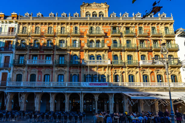 A typical building in Pamplona main square named Plaza del Castillo. On the ground floor there is Cafè Iruna, an historic coffee shop frequented by Ernest Heminway stock photo