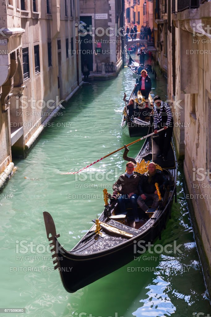 typical canal in Venice, Italy, with gondolas royalty-free stock photo
