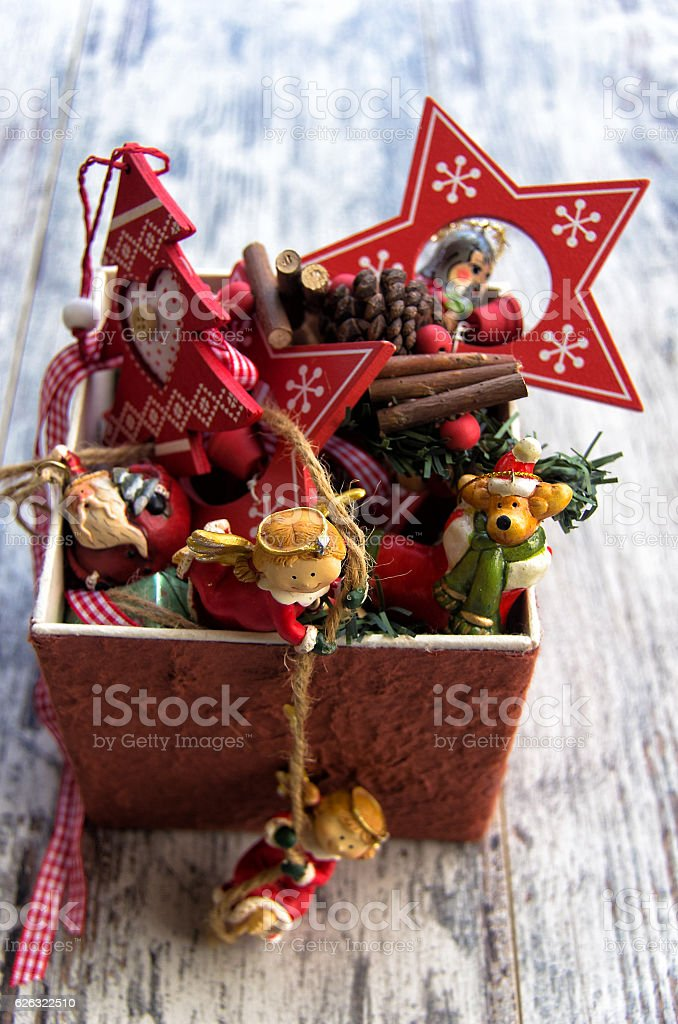 Typical Christmas decorations in a box on wooden background stock photo