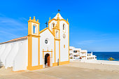 Typical church in Luz town on coast of Portugal