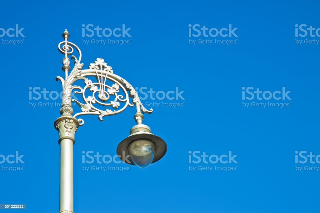 Typical classic Irish streetlight against a blue background stock photo
