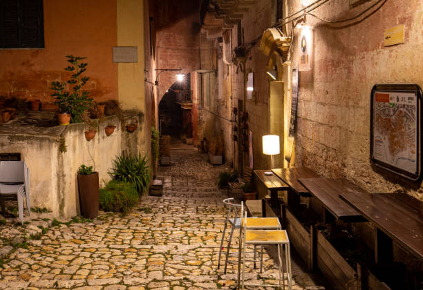 Typical cobbled stairs in a side street alleyway iin the Sassi di Matera a historic district in the city of Matera. Basilicata. Italy