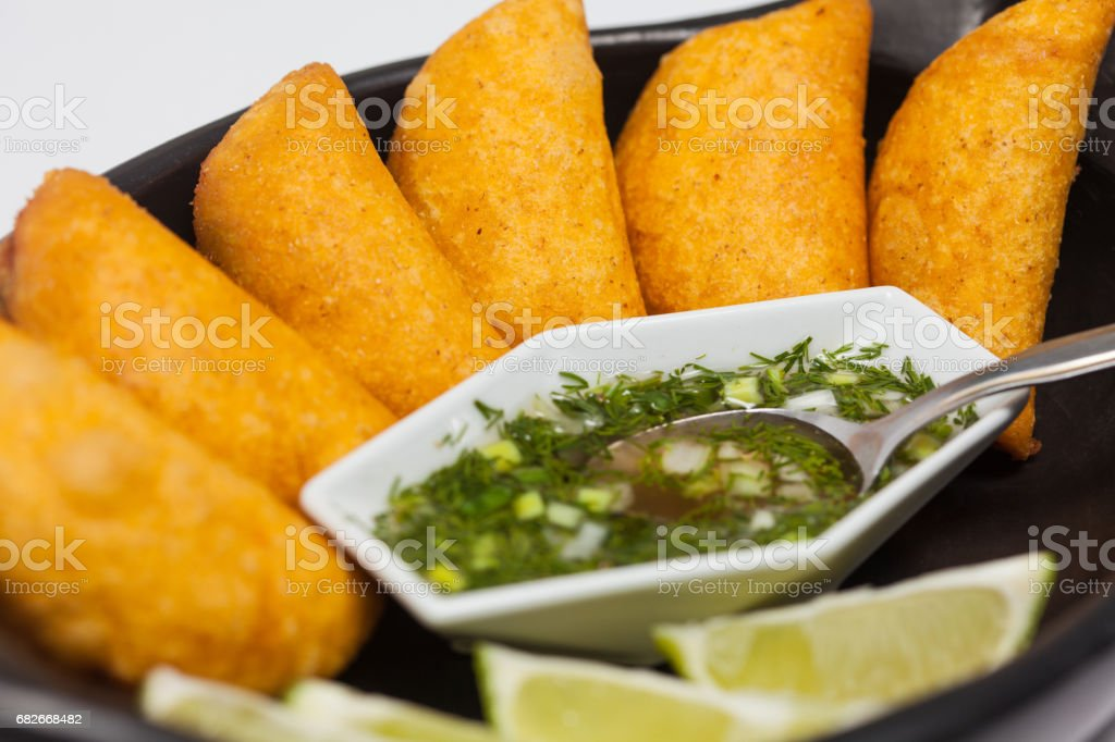 Typical Colombian empanadas served with spicy sauce stock photo