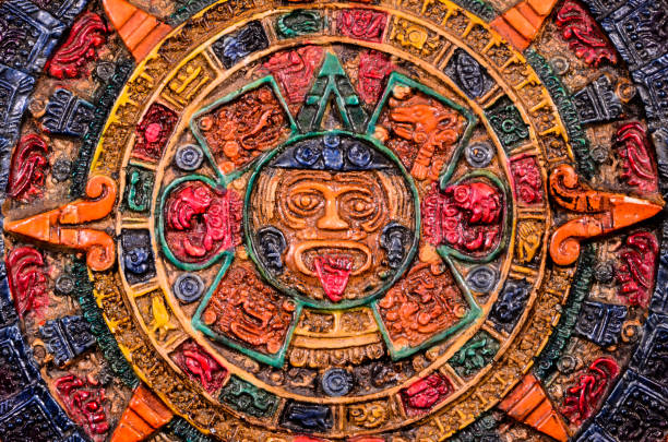 Typical Colored Clay Maya Calendar Typical Colored Clay Maya Calendar Isolated on Blackbackground 2012 stock pictures, royalty-free photos & images