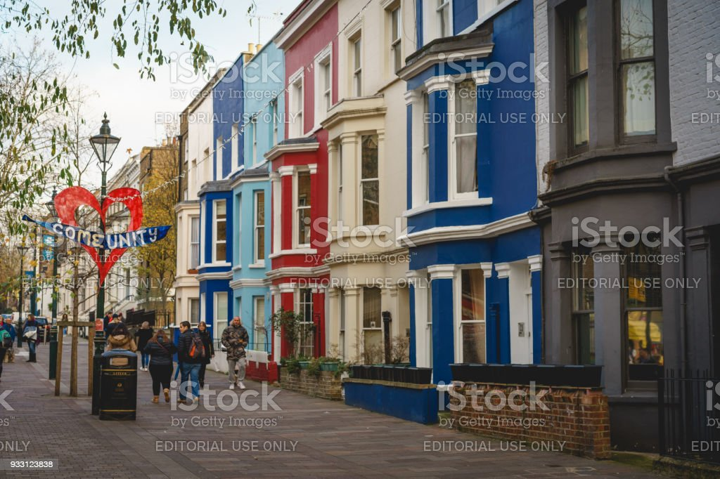 Typical coloured terraced houses in Portobello Road in Notting Hill area, London (UK). stock photo