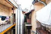 Typical courtyard for hanging clothes in summer drying on rack clothesline line in Ukraine by old vintage Lviv Ukrainian apartment buildings