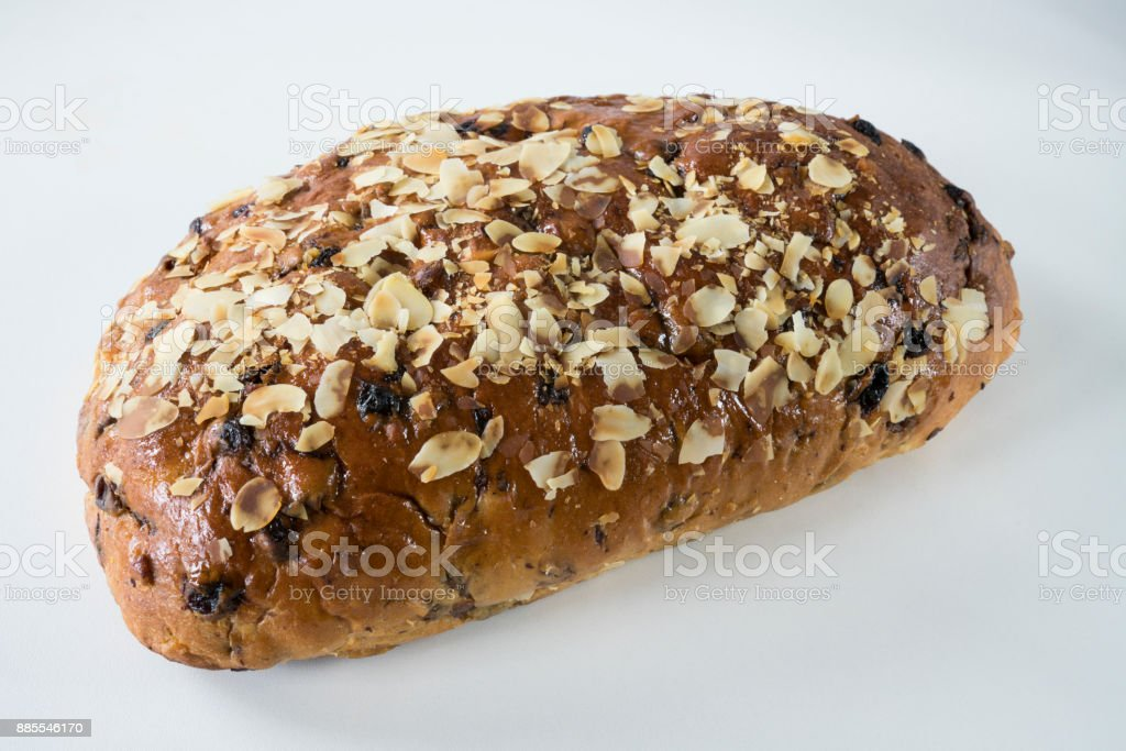 typical Dutch and German Christmas bread with almond paste, kerststol, against white background stock photo