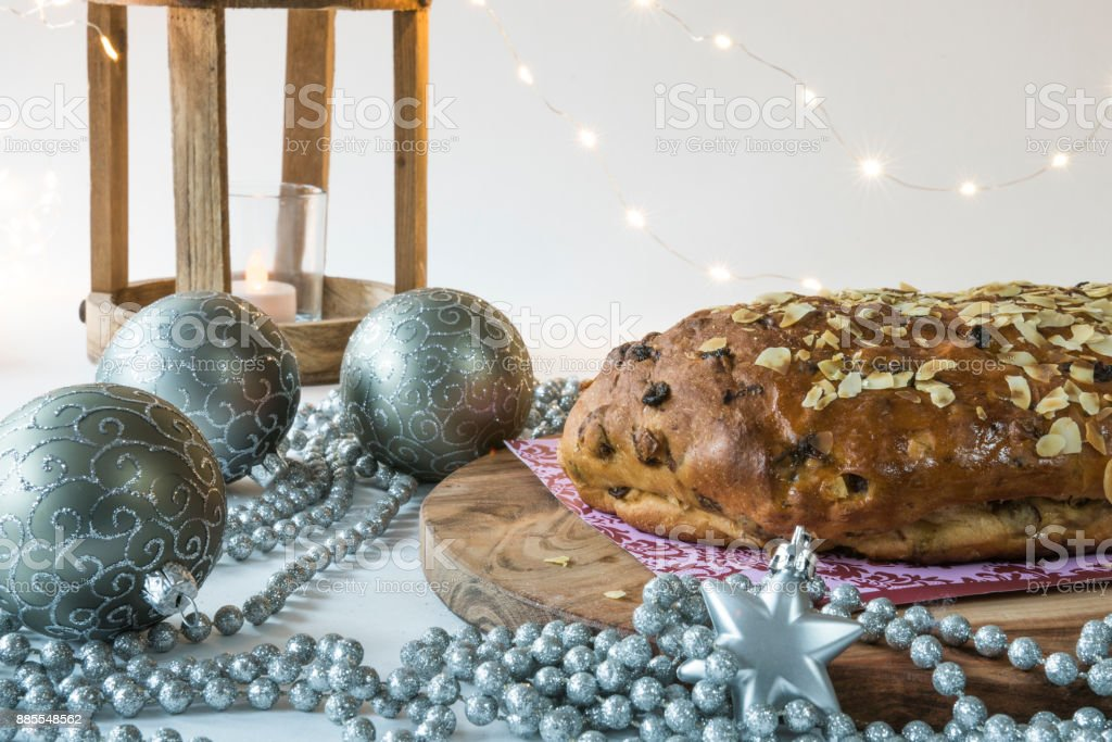 typical Dutch and German Christmas bread with almond paste, kerststol, against white blur background stock photo
