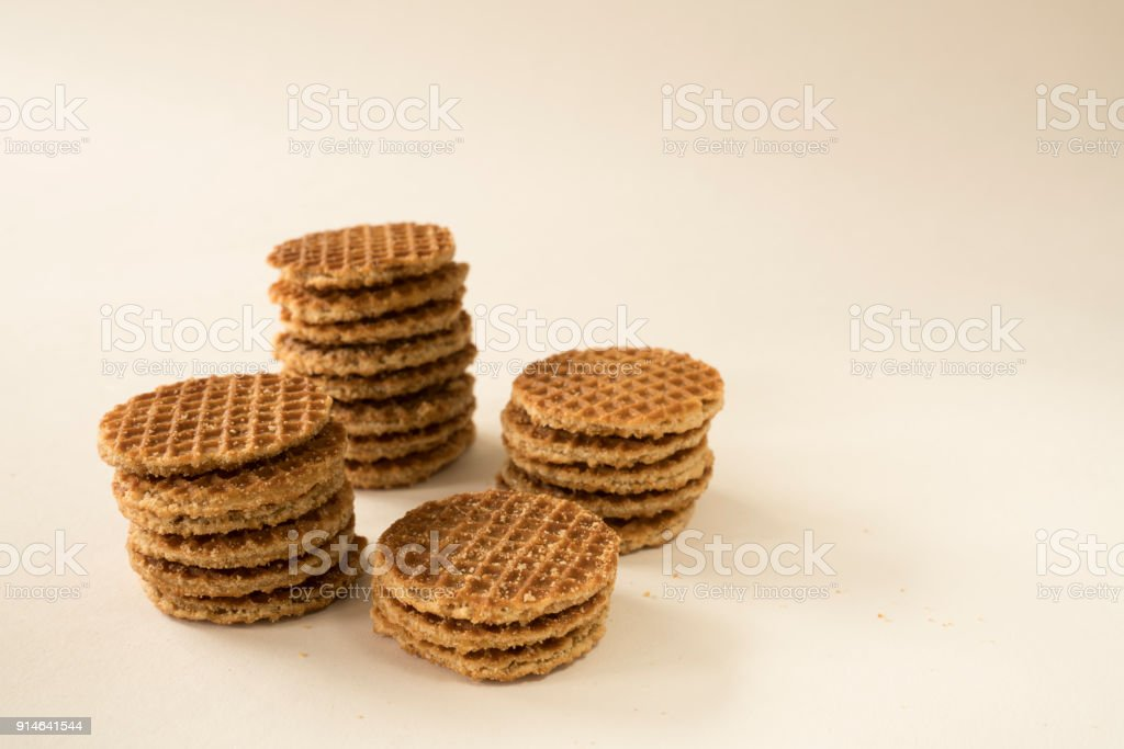 typical Dutch food cookie stroopwafel, against white background stock photo