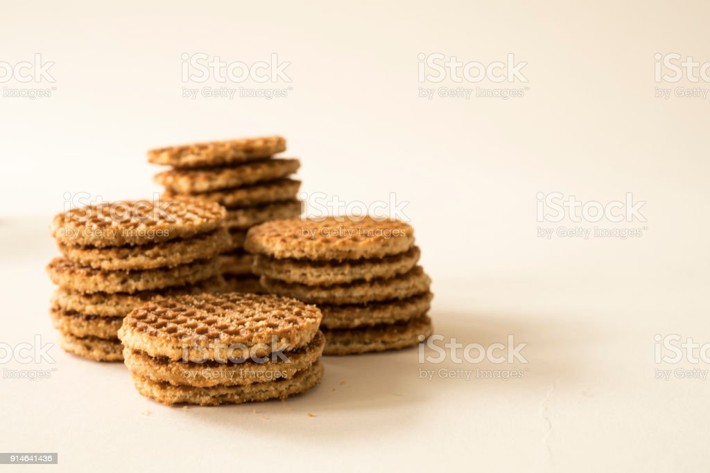 typical Dutch food cookie stroopwafel, against white background, space for text stock photo