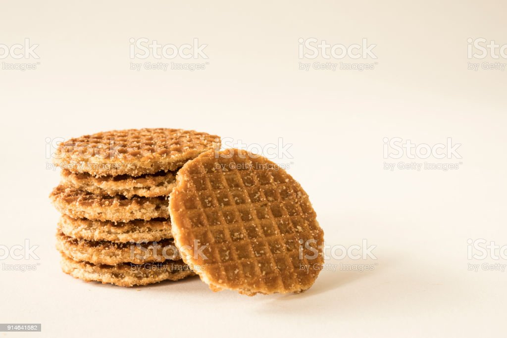 typical Dutch food cookie stroopwafel, against white background, space for text, stock photo
