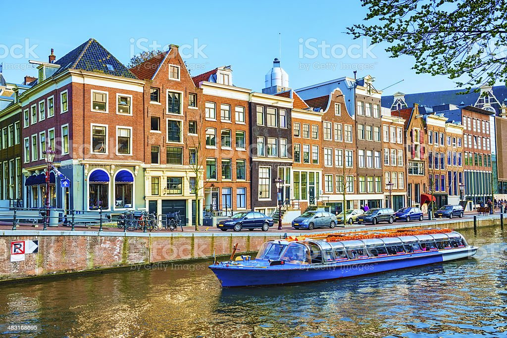 Typical Dutch Houses and Canal in the Center of Amsterdam royalty-free stock photo