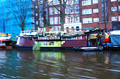 Amsterdam, Holland - January 5, 2017: Water channels with traditional house boats. Water channels are busy with traditional house boats.