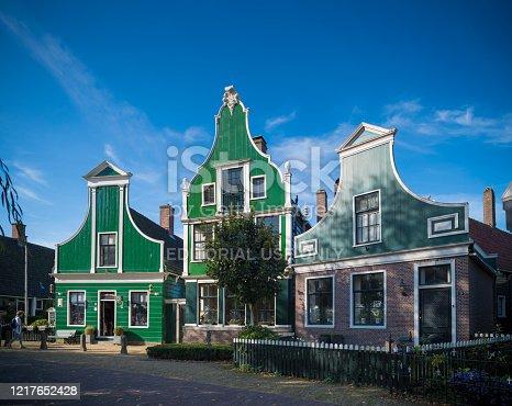 Zaanse Schans, Netherlands - October 13, 2018:: Typical houses in the Zaanse Schans, a neighborhood with historic wooden buildings in the municipality of Zaanstad.