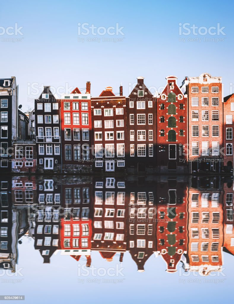Typical Dutch Houses reflections at night on the water of the canal stock photo