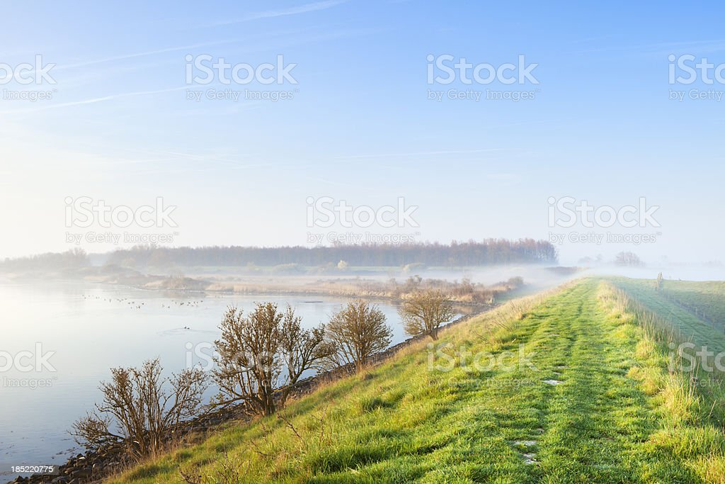 Typical Dutch landscape in Zeeland on a foggy morning stock photo
