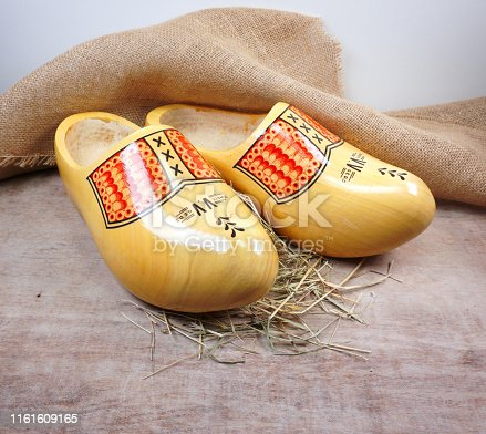 istock Typical dutch wooden clogs (klompen), painted with burlap/hessian and straw like old tradition Dutch culture and farming 1161609165