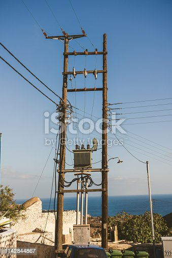 Typical electric pole in Santorini, Greece