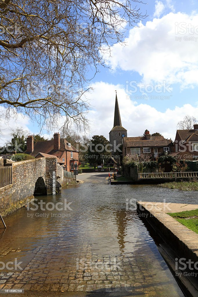 typical english village with ford bridge and church royalty-free stock photo