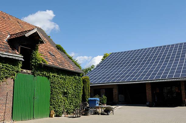 typical farm buildings one with solar panels on the roof - solar panel bildbanksfoton och bilder