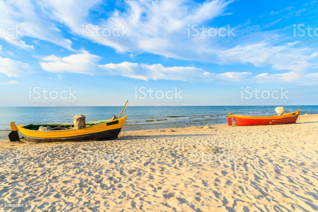 Typical fishing boats on a beach in Debki coastal village at sunset time, Baltic Sea, Poland stock photo