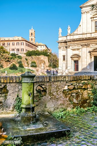 A typical fountain of drinking water of Rome, located in the heart of the city near the Roman Forum. This fountains are known among the Romans as 'nasone' (big nose) due to the shape of its tap. On the background the Capitoline Hill (Campidoglio). Image in High Definition format.