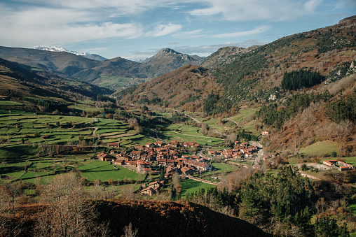 Typical green landscape with mountains and a village in Cantabria, Spain