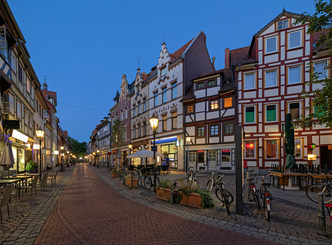 Typical half-timbered houses in twilight at dusk in old town of Goettingen, Lower Saxony, Germany