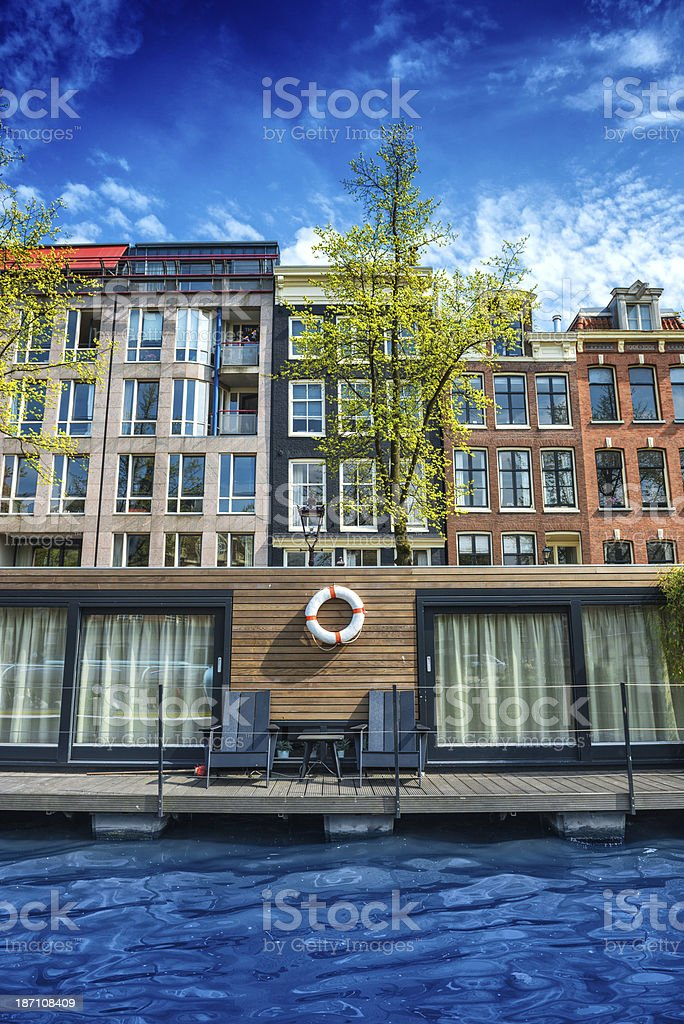 Typical House boat on Amsterdam City Canal royalty-free stock photo