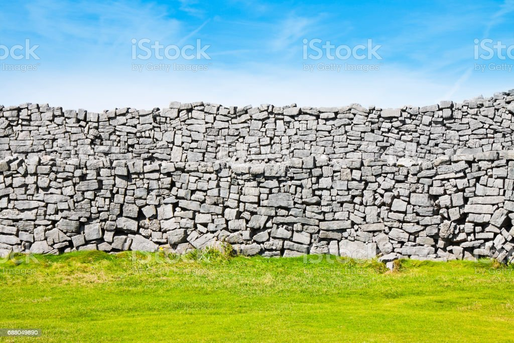 Typical Irish wall to divide pastures (Ireland) stock photo