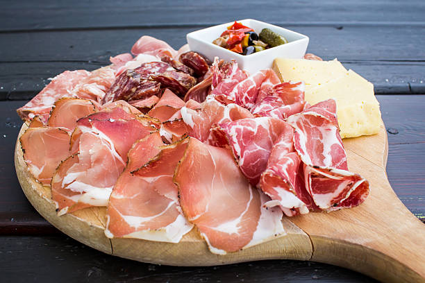 typical Italian appetizer with salami, cheese and pickles stock photo