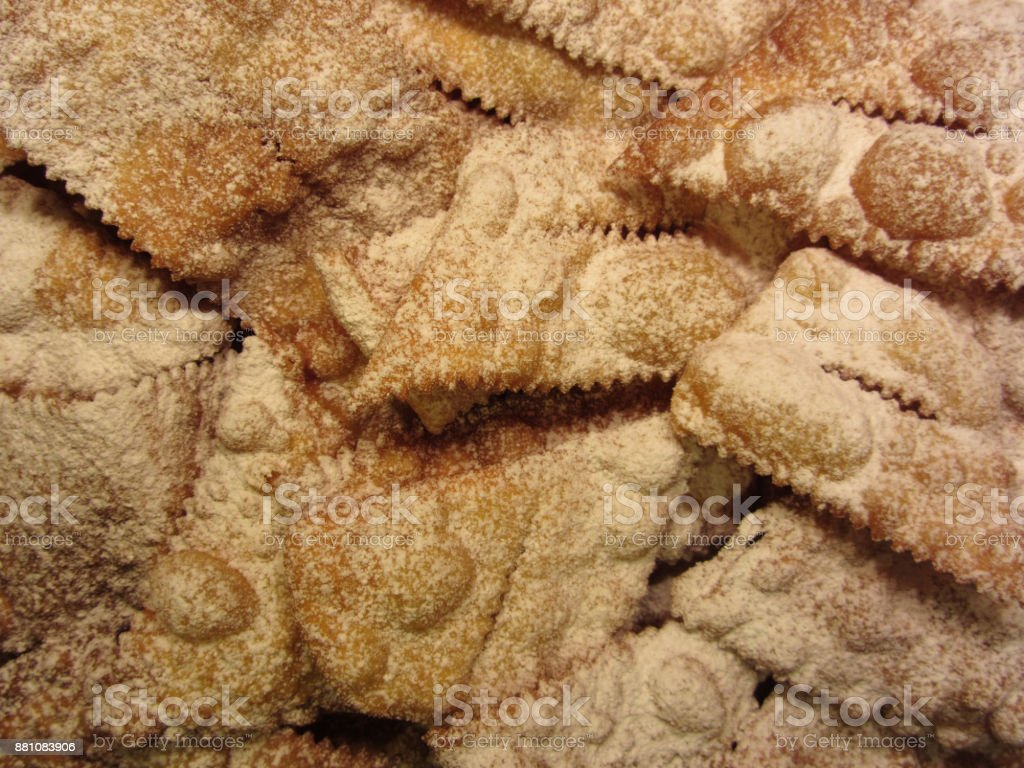 Typical italian carnival sweets . Fritters with powdered sugar known in Italy as chiacchiere or frappe or bugie stock photo