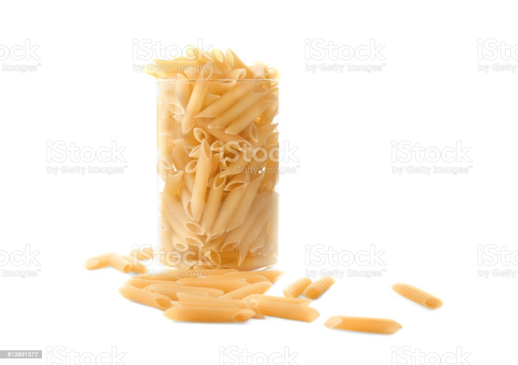 Typical Italian food pasta in a jar, isolated on a white background.  Pasta, macarons, noodle, spaggeti in a glass. stock photo