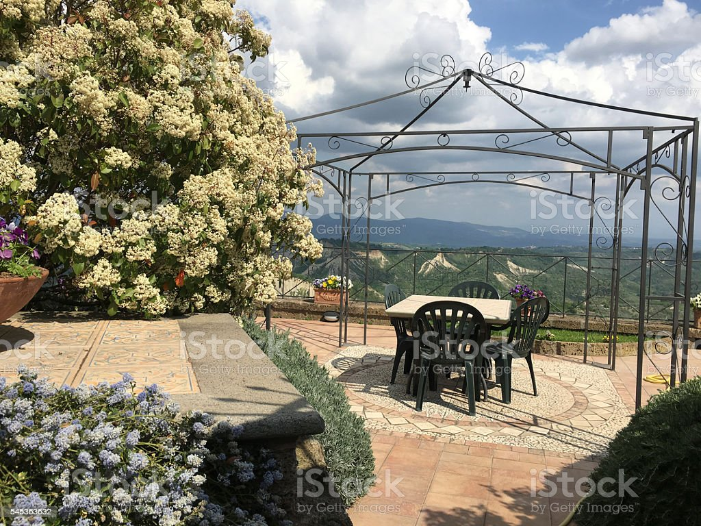Typical Italian terrace with gazebo and flowers. stock photo