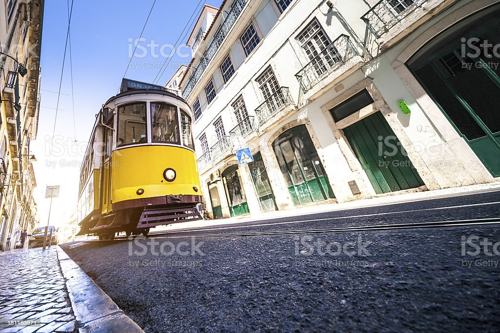 Typical Lisbon road with a yellow tram stock photo