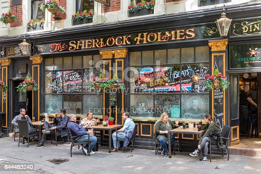 istock Typical London pub with guests in front of the pub 844463240