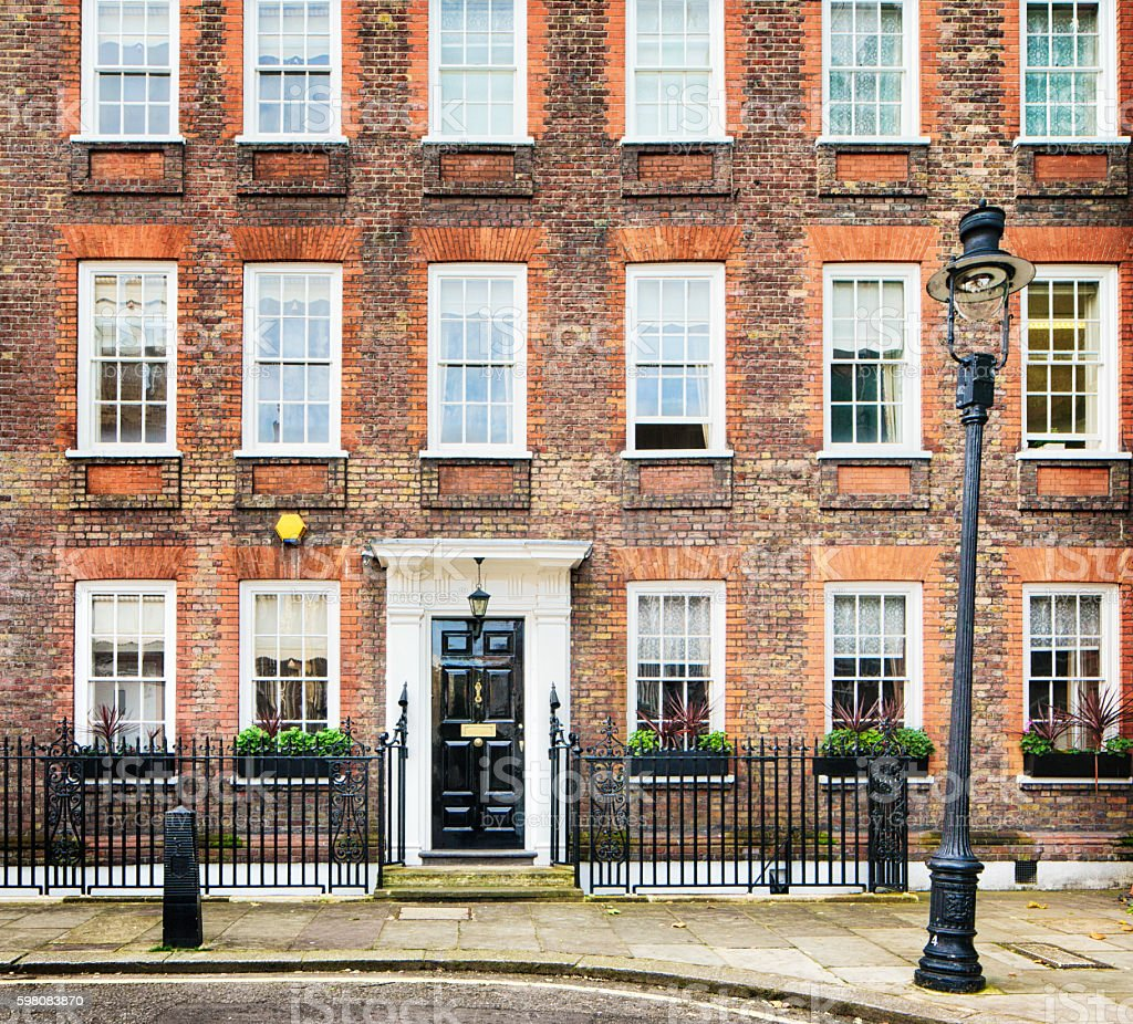Typical London UK apartment building with street lamp stock photo