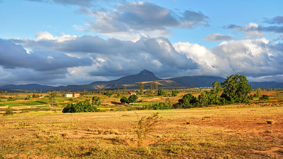 istock Typical Madagascar landscape - green and yellow rice terrace fields on small hills with clay houses in distance - Andringitra region near Sendrisoa 1270430002